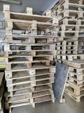 Wooden pallet packed in a row. royalty free stock photography