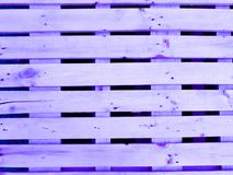 Wooden pallet stack. In purple color for background, violet pallet Royalty Free Stock Photo