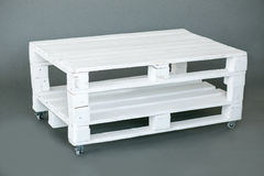 The wooden pallet. The wooden white pallet handmade on the gray floor for decor Stock Images