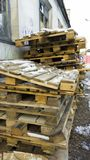 Wooden pallets, dirty old transport pallets outdoor stock photos