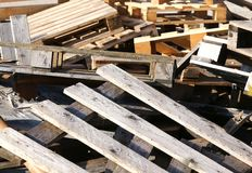Wooden pallets piled in a landfill Royalty Free Stock Images