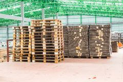 The wooden pallets, pallets ready for use packing keep material boxes or product boxes in warehouse area stock photo