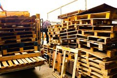 Wooden pallets stack at the freight cargo warehouse for transportation and logistics industrial at Bangkok