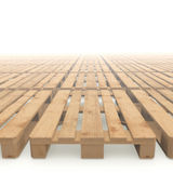 Wooden pallets stacked to the horizon. Lots of wooden pallets stacked on a white background disappearing in the fog Stock Photography