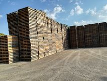 Wooden pallets stored. Wooden pallets in a row, stored for logistics industry Royalty Free Stock Photography
