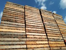 Wooden pallets stored. Wooden pallets in a row, stored for logistics industry Royalty Free Stock Photos