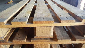 Wooden pallets in warehouse royalty free stock photos