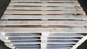 Wooden pallets in warehouse royalty free stock photography
