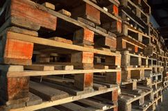 Wooden pallets. wood texture. Pallets stacked in piles.  Stock Photos