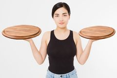 Wooden pan. Young asian woman in summer tshirt holding empty pizza tray isolated on white background. Copy space and mock up. Blank template t shirt background stock photography