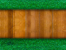 Wooden panel with green grass for background Royalty Free Stock Photo