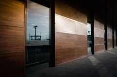 Wooden Panel Walls With Windows And Shades Royalty Free Stock Photography
