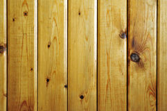 Wooden panelling. Old yellow wooden panelling texture close-up Stock Images
