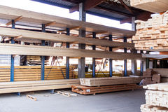 Wooden panels stored inside a warehouse Stock Images