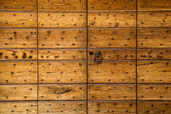 Wooden panels studded with nails Royalty Free Stock Photo
