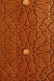 Wooden pannel. A wooden pannel with engraved arabesque Royalty Free Stock Photo