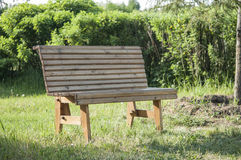 Wooden park bench Royalty Free Stock Photo
