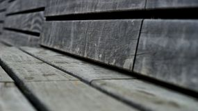 Wooden park bench. Closeup of wooden park bench Royalty Free Stock Photography