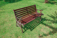 Wooden Park Bench on field grass with sunlight,Bench Chair Royalty Free Stock Photography