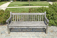 Wooden park bench in the garden Royalty Free Stock Images