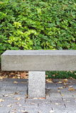 Wooden park bench in the garden Royalty Free Stock Photography