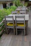 Wooden park bench in the garden. White Wooden park bench in the garden Stock Photos