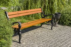 Wooden park bench with metal railings. In landscape design stock photography