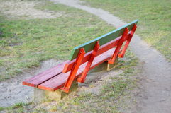 Wooden park bench. Painted in red and green stock photos