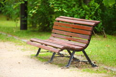 Wooden park bench at a park Stock Photos
