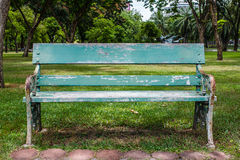 Wooden park bench at a park Stock Images