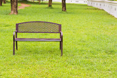 Wooden park bench at the public park image Stock Image