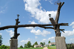Wooden park gate tree trunk rural homestead house Stock Photography