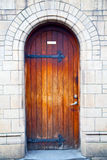 Wooden parliament in door and marble antique  wall Royalty Free Stock Image
