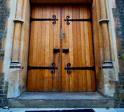 Wooden parliament in london old church door and marble antique Royalty Free Stock Image