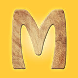 Wooden parquet alphabet letter symbol - M. Isolated on white background Stock Photos
