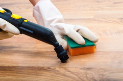 Wooden, parquet, laminate floors cleaning with steam in the room Stock Photos