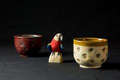 Wooden parrot and ceramic mug Stock Photo