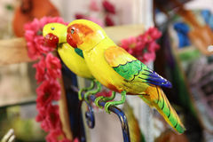 Wooden parrots Stock Images