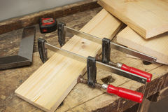 Wooden parts are clamped clamps, bonding Royalty Free Stock Photography