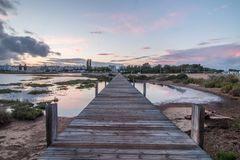 Wooden passage over the water Stock Images