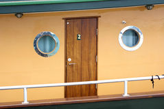 Wooden passenger cabin with round portholes on a Historic Steam Stock Image