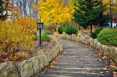 Wooden path autumn park Royalty Free Stock Images