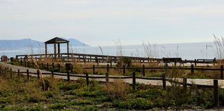 Wooden path on the beach stock photos