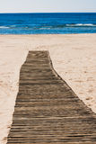 Wooden path on the beach Royalty Free Stock Images
