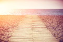 Wooden path to the sea. Wooden path on the beach to the sea Stock Photo