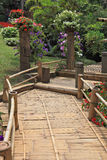 A wooden path among flower beds Stock Photo