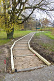 Wooden path foundation construction in park Royalty Free Stock Image