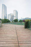 Wooden path with high-rise buildings Royalty Free Stock Images