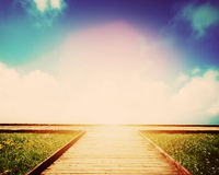 Wooden path leading to crossroads. Direction, way to choose Royalty Free Stock Photography
