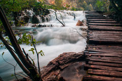 Wooden path over the waterfall Royalty Free Stock Photos